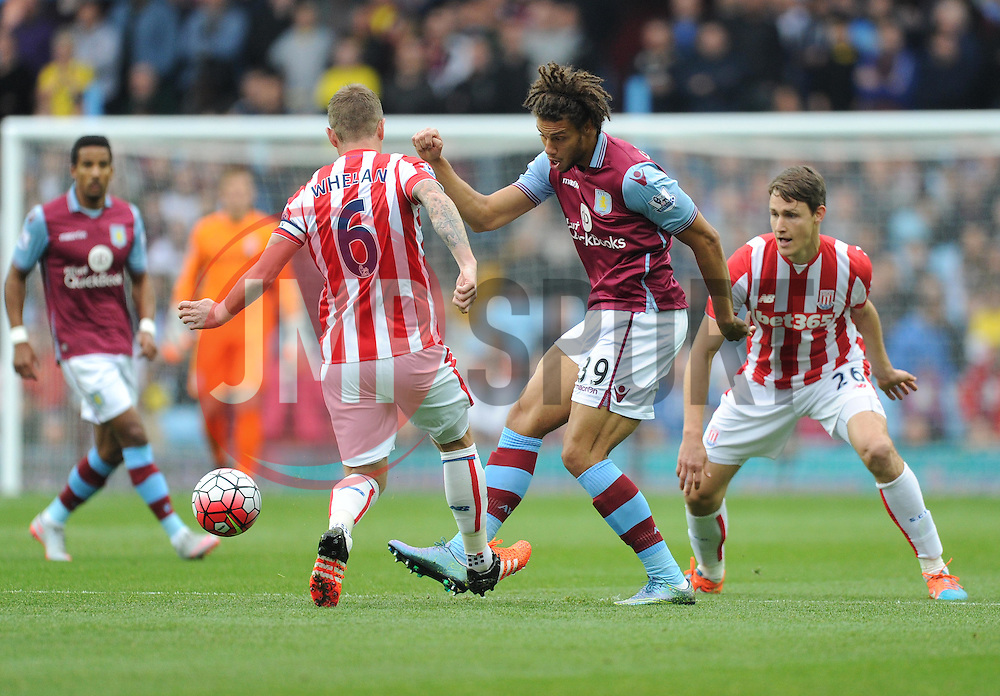 Rudy Gestede of Aston Villa passes away from Glenn Whelan of Stoke City - Mandatory byline: Alex James/JMP - 07966 386802 - 03/10/2015 - FOOTBALL - Villa Park - Birmingham, England - Aston Villa v Stoke City - Barclays Premier League