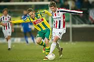 18-12-2010 ADO DEN HAAG - WILLEM II<br /> Jens Toornstra (L) in duel met Jan-Arie van der Heijden (R)<br /> foto: Geert van Erven
