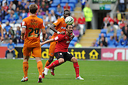 Cardiff city's Tommy Smith © holds off the attention of Tongo Doumbia of Wolves. NPower championship, Cardiff city v Wolverhampton Wanderers at the Cardiff city stadium in Cardiff, South Wales on Sunday 2nd Sept 2012. pic by  Andrew Orchard, Andrew Orchard sports photography,