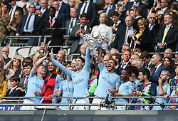 Kyle Walker and John Stones of Manchester City lift the trophy in celebration - Mandatory by-line: Arron Gent/JMP - 18/05/2019 - FOOTBALL - Wembley Stadium - London, England - Manchester City v Watford - Emirates FA Cup Final