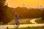 UNITED KINGDOM, London: 25 July 2019 <br /> A cyclist makes her way through Richmond Park as the sun rises on what could be the hottest day ever recorded in Britain. Temperatures are set to reach up to 39 degrees Celsius later today.<br /> Rick Findler / Story Picture Agency