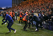 Lincoln City fans invade the pitch past stewards during the The FA Cup fourth round match between Lincoln City and Brighton and Hove Albion at Sincil Bank, Lincoln, United Kingdom on 28 January 2017. Photo by Phil Duncan.