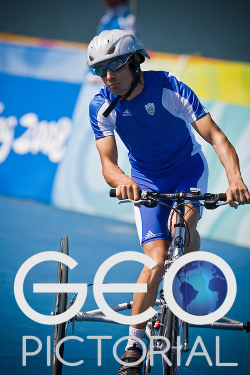 BEIJING, SEPTEMBER 12: Stamatios Kotzias of Greece in the Road Cycling Road Race mixed CP1/CP2  at the Triathlon Venue during day six of the 2008 Paralympic Games on September 12, 2008 in Beijing, China.