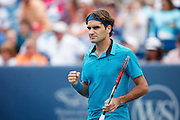 CINCINNATI, OH - AUGUST 22: Roger Federer of Switzerland pumps his fist following his match with Andy Murray of Great Britain during day six of the Western & Southern Financial Group Masters on August 22, 2009 at the Lindner Family Tennis Center in Cincinnati, Ohio. Federer defeated Murray 6-2, 7-6. (Photo by Joe Robbins)