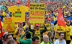 """More than 2,000 Opel workers and union leaders from across Europe, take part in a demonstration to protest against the threatened closure of the carmaker's plant in Belgium, outside the Opel assembly plant in Antwerp, Wednesday, Sept. 23, 2009.  The sentence on the t-shirts reads: """"We are all Opel"""". (Photo © Jock Fistick)"""