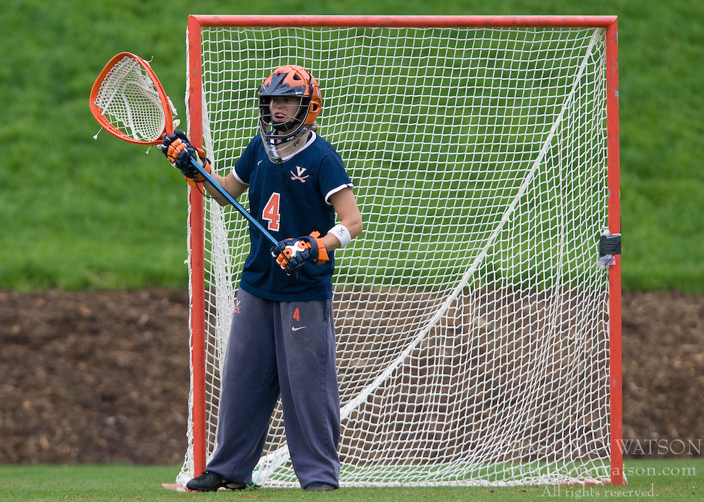 Virginia Cavaliers GK Kendall McBrearty (4) in action against Maryland.  The #3 ranked Virginia Cavaliers defeated the #2 ranked Maryland Terrapins 10-9 in overtime in the finals of the Women's 2008 Atlantic Coast Conference Lacrosse tournament at the University of Virginia's Scott Stadium in Charlottesville, VA on April 27, 2008.