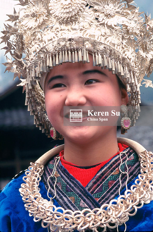 Miao girl in traditional costume and silver hairdress, Langde, Guizhou Province, China