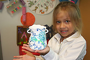 Avriana shows off the vase she made while studying China in Laurenzo ECC's International Expo.