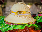"14 JANUARY 2015 - BANGKOK, THAILAND:  A woven pith helmet worn by a participant in the 2015 Discover Thainess parade. The Tourism Authority of Thailand (TAT) sponsored the opening ceremony of the ""2015 Discover Thainess"" Campaign with a 3.5-kilometre parade through central Bangkok. The parade featured cultural shows from several parts of Thailand. Part of the ""2015 Discover Thainess"" campaign is a showcase of Thailand's culture and natural heritage and is divided into five categories that match the major regions of Thailand – Central Region, North, Northeast, East and South.    PHOTO BY JACK KURTZ"