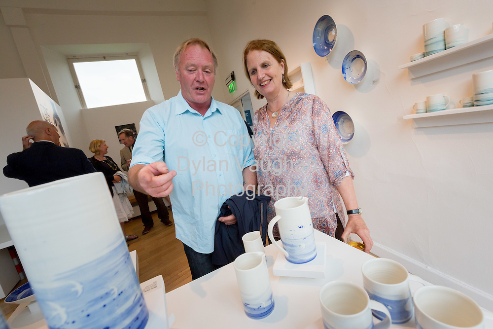 Repro Free No Charge for use<br /> <br /> 15-7-16<br /> <br /> Shem Caulfield and Elinor Mountain pictured at the opening of Cr&eacute;, an exhibition of work by the 2016 graduates of the Design &amp; Crafts Council of Ireland&rsquo;s Ceramics Skills &amp; Design Course. <br /> <br /> The exhibition was officially opened by Dr. Audrey Whitty, Keeper of the Art and Industrial Division, National Museum of Ireland &ndash; Decorative Arts &amp; History. <br /> <br /> Cr&eacute; is open at the National Craft <br /> Gallery, Kilkenny until 1st August 2016.<br /> <br /> Picture Dylan Vaughan