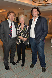 Left to right, HOWARD JACOBSON, his wife ENNY DE YONG and JAY RAYNER at a party to celebrate the publication of 'Let's Eat meat' by Tom Parker Bowles held at Fortnum & Mason, Piccadilly, London on 21st October 2014.