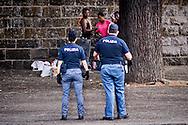 Roma 13 Giugno 2015<br /> I migranti nel centro di accoglienza  per migranti 'Baobab' vicino alla stazione ferroviaria Tiburtina di Roma. Centinaia di  migranti provenienti da Etiopia, Somalia ed Eritrea, tutti  arrivati negli ultimi mesi dalla Libia con i barconi e portati in Italia dopo essere stati salvati in mare. La polizia allontana i migranti che sono per la strada per spostarli  al centro di accoglienza  per migranti 'Baobab'.<br /> Rome June 13, 2015<br /> Migrants in the reception center for migrants 'Baobab' close to the Tiburtina train station in Rome. Hundreds of migrants mainly from Ethiopia, Somalia and Eritrea, all arrived in recent months from Libya with the barges and taken to Italy after being rescued at sea. The police away migrants who are on the street to move them to the reception center for migrants 'Baobab'.