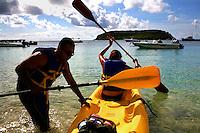 Eric and Cristina Menjivar, of Los Angeles, Ca., load up the kayak at Playa Esperanza, Vieques, Puerto Rico.