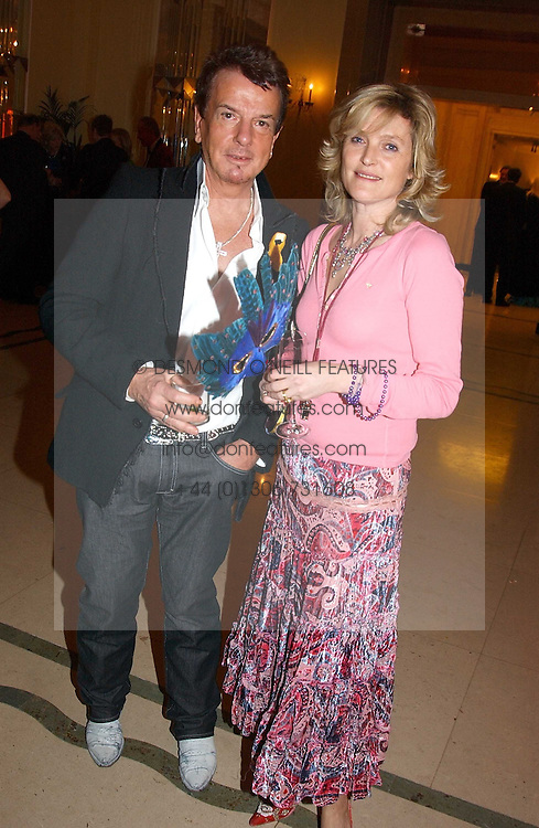 LAURA HARRIS and NICKY HASLAM at 'A Rout' an evening of late evening party, essentially of revellers in aid of the Great Ormond Street Hospital Children's Charity and held at Claridge's, Brook Street, London W1 on 25th January 2005.<br />
