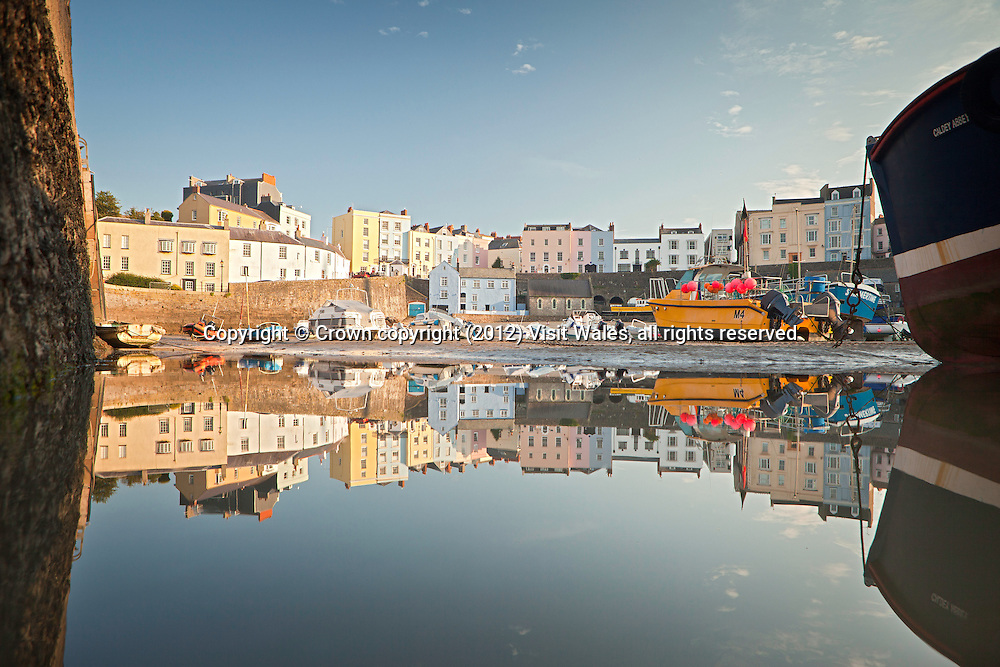 Tenby Harbour with houses reflected in still water<br /> Tenby<br /> Pembrokeshire<br /> South<br /> Towns and Villages