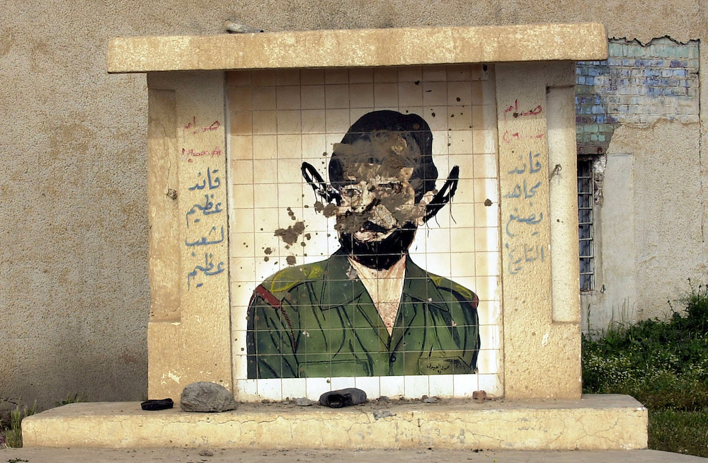 A vandalized portrait of Saddam located along a road in the northern Iraqi city of Karkuk.  (Alan Lessig/Air Force Times)