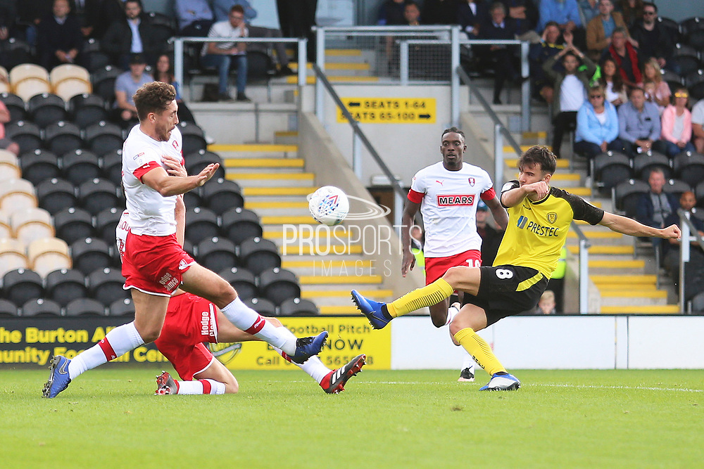 Burton Albion midfielder Scott Fraser (8) shoots at goal during the EFL Sky Bet League 1 match between Burton Albion and Rotherham United at the Pirelli Stadium, Burton upon Trent, England on 17 August 2019.