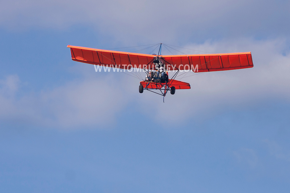 Middletown, New York - An experimental aircraft flies over Randall Airport on April 12, 2014. The MX II Sprint ultralight is powered by a four-cycle engine. ©Tom Bushey / The Image Works