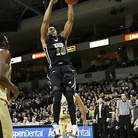 Central Florida forward Dwight McCombs (10) slams the ball during the NCAA basketball game against the USF Bulls at the UCF Arena on November 18, 2010 in Orlando, Florida. UCF won the game 65-59. (AP Photo/Alex Menendez)