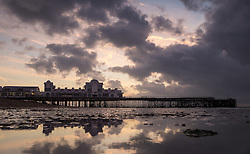 © Licensed to London News Pictures. 04/10/2016. Southsea, Hampshire, UK.  Dawn colours light up the sky  as the sun rises over South Parade Pier in Southsea this morning, 4th October 2016. Today will be another dry and sunny, but breezy, autumn day in the south of England. Photo credit: Rob Arnold/LNP