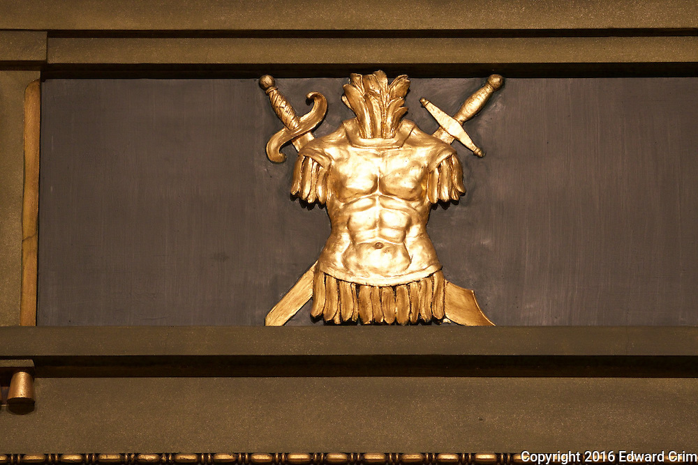 A war motif of a breastplate with crossed swords behind decorates the north wall of the Pennsylvania capitol's senate chamber in Harrisburg.