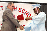 Keith L. Lightfoot gets a handshake from principal David White during the 55th Annual Belmont High School commencement at the new BHS gymnasium, Saturday, May 19, 2012.  1,700 tickets were sold to the 2012 'Imagine' commencement.