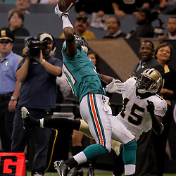 2009 September 03: Miami Dolphins cornerback Sean Smith (31) intercepts a pass over New Orleans Saints wide receiver Courtney Roby (15) during the first quarter of a preseason game between the Miami Dolphins and the New Orleans Saints at the Louisiana Superdome in New Orleans, Louisiana.