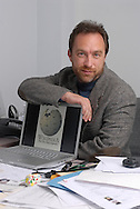 Wikipedia founder Jimmy Wales sits at his desk in his office in St. Petersburg, Florida.