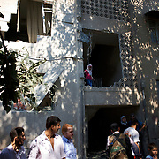 August 10, 2012 - Aleppo, Syria: Local people access the damage of their residential building cause by Syrian Army bombardments in Haneno neighborhood in central Aleppo...The Syrian Army have in the past week increased their attacks on residential neighborhoods where Free Syria Army rebel fights have their positions in Syria's commercial capital, Aleppo.
