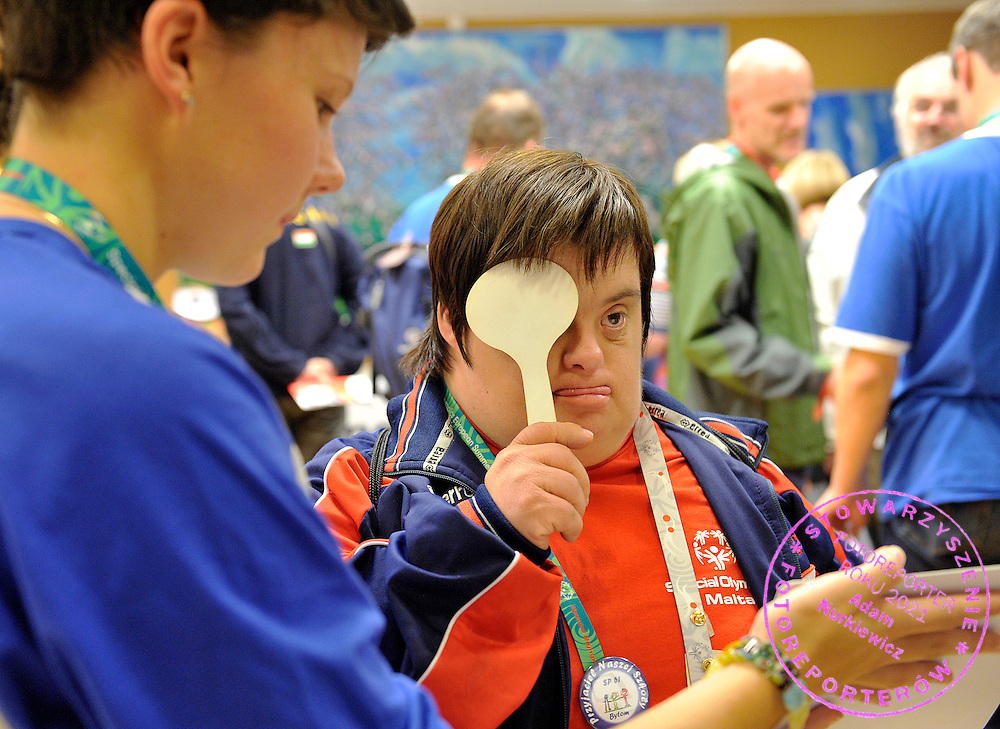 HEALTHY ATHLETES - OPENING EYES PROGRAM..SPECIAL OLYMPICS EUROPEAN SUMMER GAMES - WARSAW 2010..THE IDEA OF SEPCIAL OLYMPICS IS THAT, WITH APPROPRIATE MOTIVATION AND GUIDANCE, EACH PERSON WITH INTELLECTUAL DISABILITIES CAN TRAIN, ENJOY AND BENEFIT FROM PARTICIPATION IN INDIVIDUAL AND TEAM COMPETITIONS...WARSAW , POLAND , SEPTEMBER 19, 2010..MANDATORY CREDIT:.PHOTO BY ADAM NURKIEWICZ / MEDIASPORT