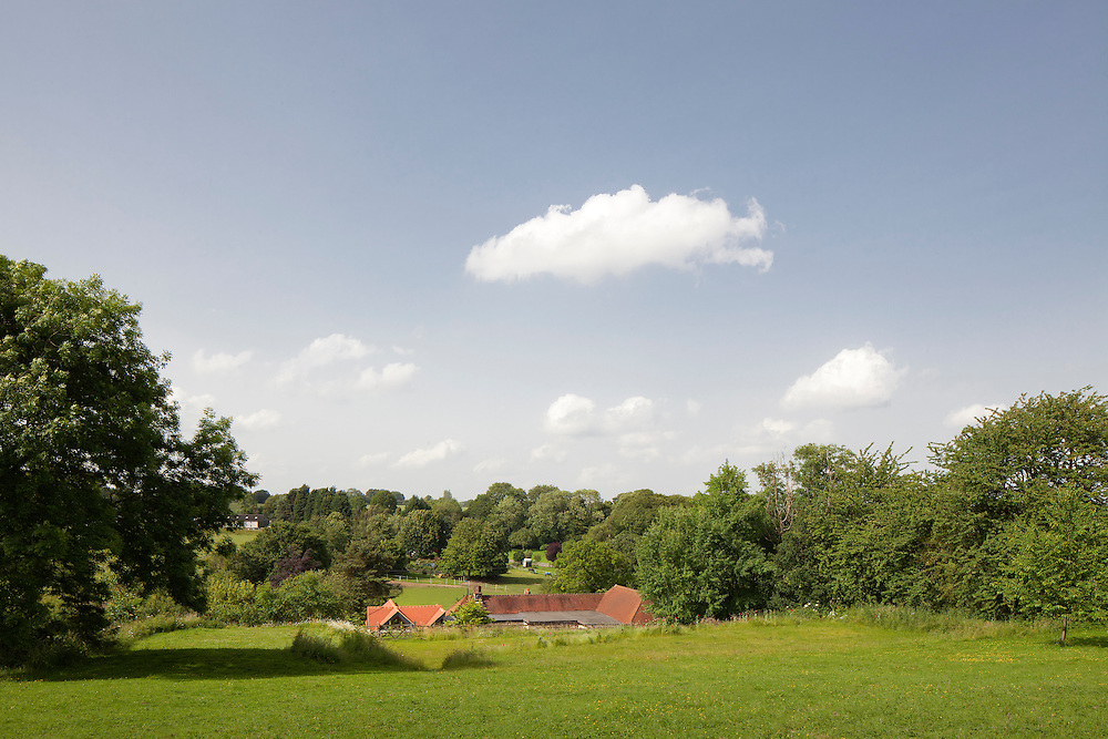 residential property tucked into hills in hertfordhshire countryside