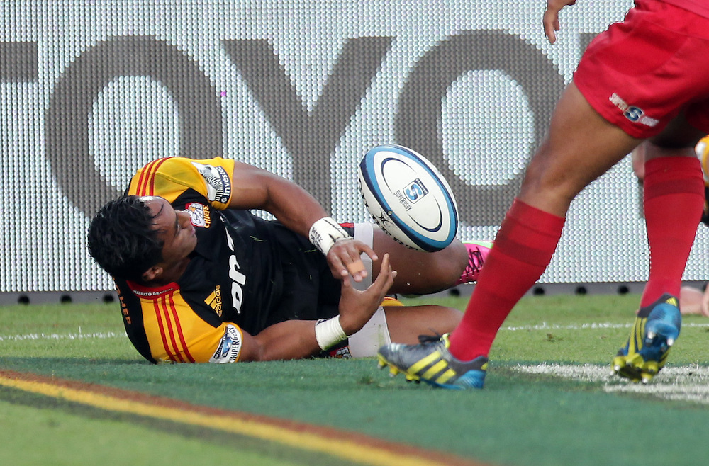Chiefs' Bundee Aki touches down a try against the Reds in a Super Rugby match, Waikato Stadium, Hamilton, New Zealand, Saturday, April 13, 2013.  Credit:SNPA / David Rowland