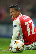 Alexis Sanchez of Arsenal looks on after a heavy challenge during the UEFA Champions League match against Borussia Dortmund at the Emirates Stadium, London<br /> Picture by Richard Calver/Focus Images Ltd +447792 981244<br /> 26/11/2014