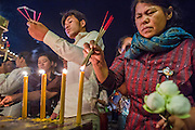 02 FEBRUARY 2013 - PHNOM PENH, CAMBODIA: Cambodians light incense before praying for former King Norodom Sihanouk at a shrine near the Royal Palace in Phnom Penh. Much of Phnom Penh has been shut down to honor former King Norodom Sihanouk, who ruled Cambodia from independence in 1953 until he was overthrown by a military coup in 1970. Only bars, restaurants and hotels that cater to foreign tourists are supposed to be open. The only music being played publicly is classical Khmer music. Sihanouk died in Beijing, China, in October 2012 and will be cremated during a state funeral royal ceremony on Monday, Feb. 4.     PHOTO BY JACK KURTZ