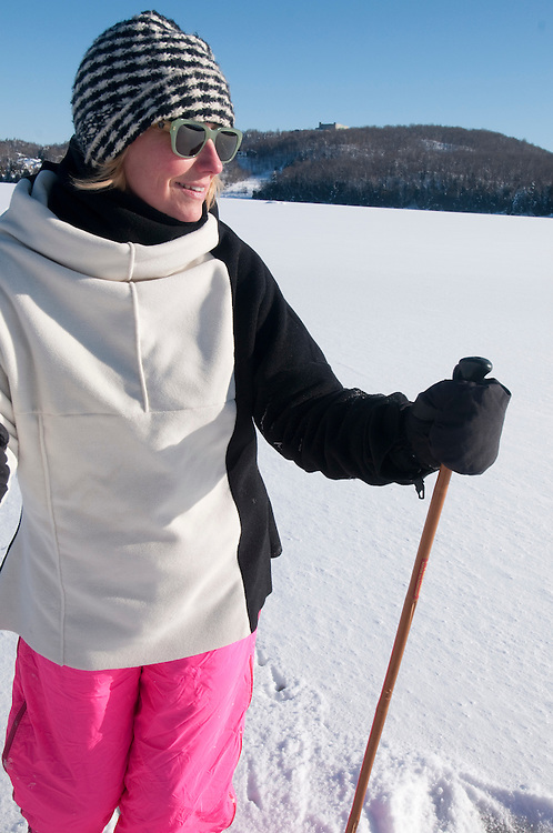 Woman cross country skiing on a lake in the Laurentides, Quebec, Canada