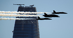 The U.S. Navy Blue Angels precision flight team fly past the Salesforce tower as they perform their air show over San Francisco Bay, Friday, Oct. 5, 2018 in San Francisco. The aerobatics are the culmination of the day's festivities, and the pilots will reprise their performance on Saturday and Sunday as part of the annual Fleet Week celebration. (Photo by D. Ross Cameron)