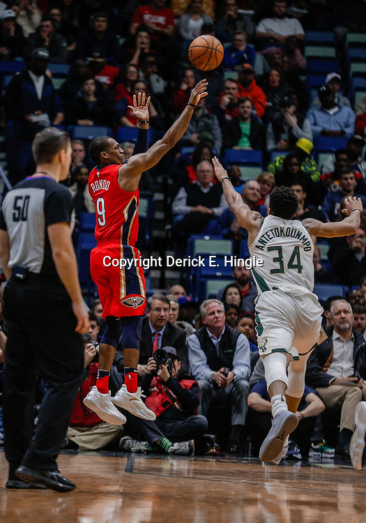 Dec 13, 2017; New Orleans, LA, USA; New Orleans Pelicans guard Rajon Rondo (9) shoots over Milwaukee Bucks forward Giannis Antetokounmpo (34) during the second quarter at the Smoothie King Center. Mandatory Credit: Derick E. Hingle-USA TODAY Sports
