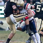 Army QB (#8) Trent Steelman with the ball late in the 2nd quarter as Navy LB (#54) Tyler Simmons makes the tackle. Navy set the tone early in the game as Navy defeats Army 31-17 in front of 69,223 at  Lincoln Financial Field in Philadelphia Pennsylvania