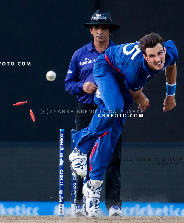 Steve Finn bowls and hits the stumps during his run up during the ICC world Twenty20 Cricket held in Sri Lanka.