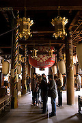 "People praying in the main building of Ishiyamadera temple where lady Murasaki started writing ""The Tale of Genji"" , a 1000 years ago.."