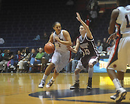 """Ole Miss' Shae Nelson (1) drives against Mississippi State's Mary Kathryn Govero (33) in a NCAA women's college basketball game at the C.M. """"Tad"""" Smith in Oxford, Miss. on Thursday, February 10, 2011.   Mississippi State won 59-43.."""