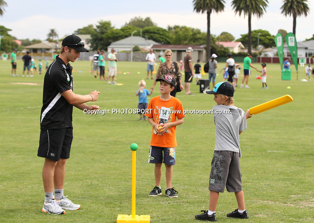 Kane Williamson helps out at the National Bank's National Cricket Club ( NCC ) Supercamp, Nelson Park, Napier, Sunday 30 January 2011. Photo: Andrew Cornaga/photosport.co.nz