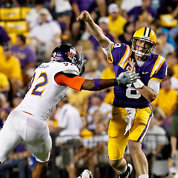 September 10, 2011; Baton Rouge, LA, USA;  LSU Tigers quarterback Zach Mettenberger (8) throws as Northwestern State Demons defensive tackle Ricky Issac (92) pressures during the second half at Tiger Stadium. LSU defeat Northwestern State 49-3. Mandatory Credit: Derick E. Hingle
