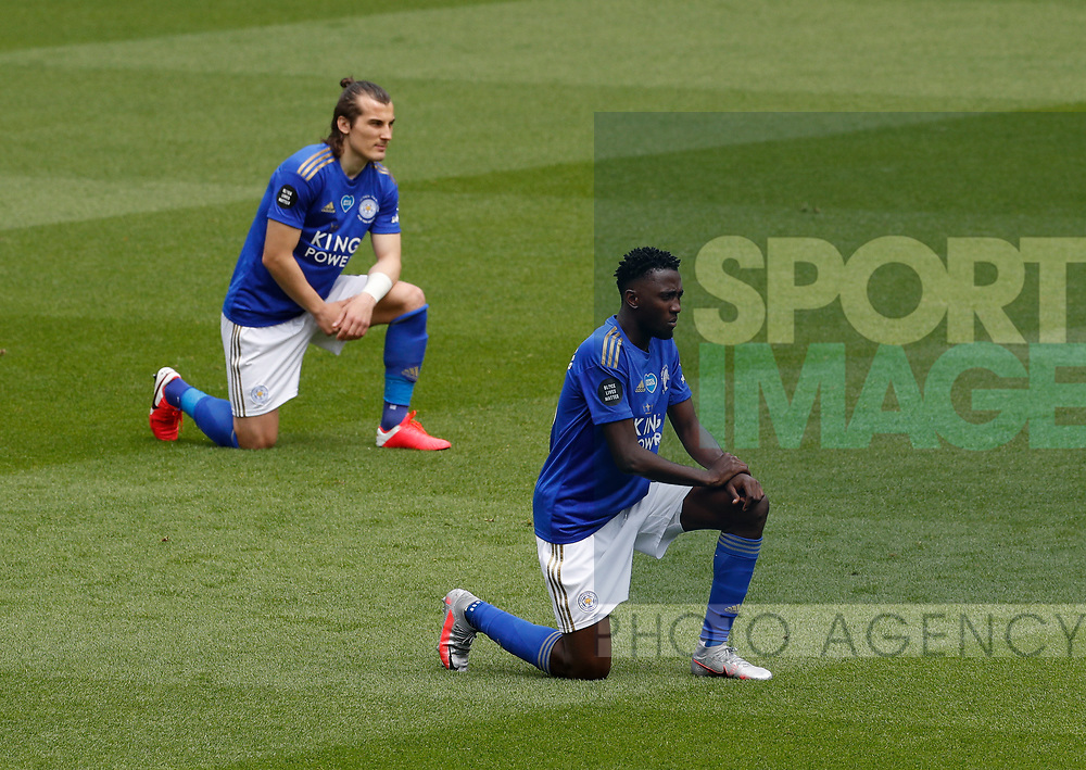 Wilfred Ndidi of Leicester City and Caglar Soyuncu of Leicester City take a knee in support of the Black Lives Matter campaign during the Premier League match at Vicarage Road, Watford. Picture date: 20th June 2020. Picture credit should read: Darren Staples/Sportimage