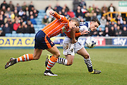 Millwall midfielder Ben Thompson and Blackpool midfielder Brad Potts during the Sky Bet League 1 match between Millwall and Blackpool at The Den, London, England on 5 March 2016. Photo by David Charbit.