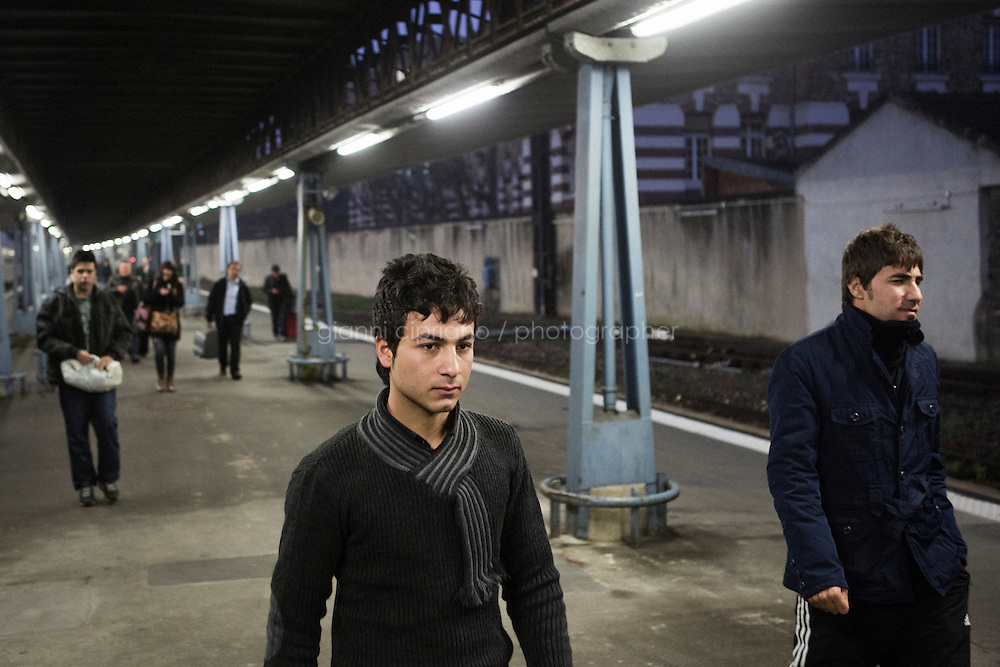 PARIS, FRANCE - 19 NOVEMBER 2014: Syrian refugees arrive at the Gare d'Austerlitz in Paris, France, on November 19th 2014.<br /> <br /> After crossing the Italian-French border, migrants take the train to Paris. Some stop in Paris, but the majority continues the journey to Calais (before arriving in London), while others go to countries such Germany, the Netherlands, and Sweden.