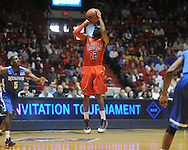 "Mississippi's Chris Warren vs. Memphis  in NIT second round basketball action at the C.M. ""Tad"" Smith Coliseum in Oxford, Miss. on Friday, March 19, 2010. Ole Miss won 90-81."