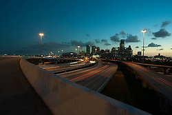 Early evening view of the Houston, Texas skyline from a northern freeway.