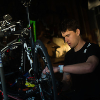 Ben Greenfield works on his racing bike in his garage in Spokane, Wash. Photo by Rajah Bose