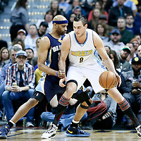 01 February 2016: Denver Nuggets forward Danilo Gallinari (8) posts up Memphis Grizzlies guard Vince Carter (15) during the Memphis Grizzlies 119-99 victory over the Denver Nuggets, at the Pepsi Center, Denver, Colorado, USA.